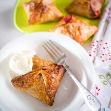 apple and raspberry puff pastry pie in a bowl with vanilla icecream