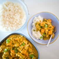 bowl of chicken and coconut curry with sweet potato with rice