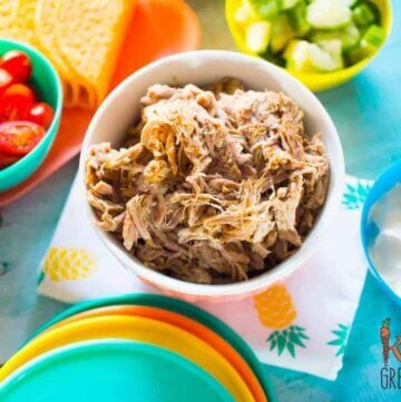 pineapple and lime pulled pork, one of the easiest and tastiest recipes you can make in a slow cooker. Perfect for summer dinners and lunches!