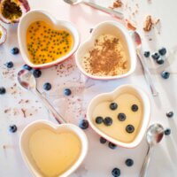 vanilla pannacotta with different topping, chocolate, blueberries and passionfruit