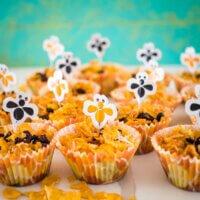 healthier honey joys in honeycomb design cupcake liners with bee cupcake picks