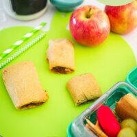 apple pie cookies on an apple shaped chopping board and in a lunchbox