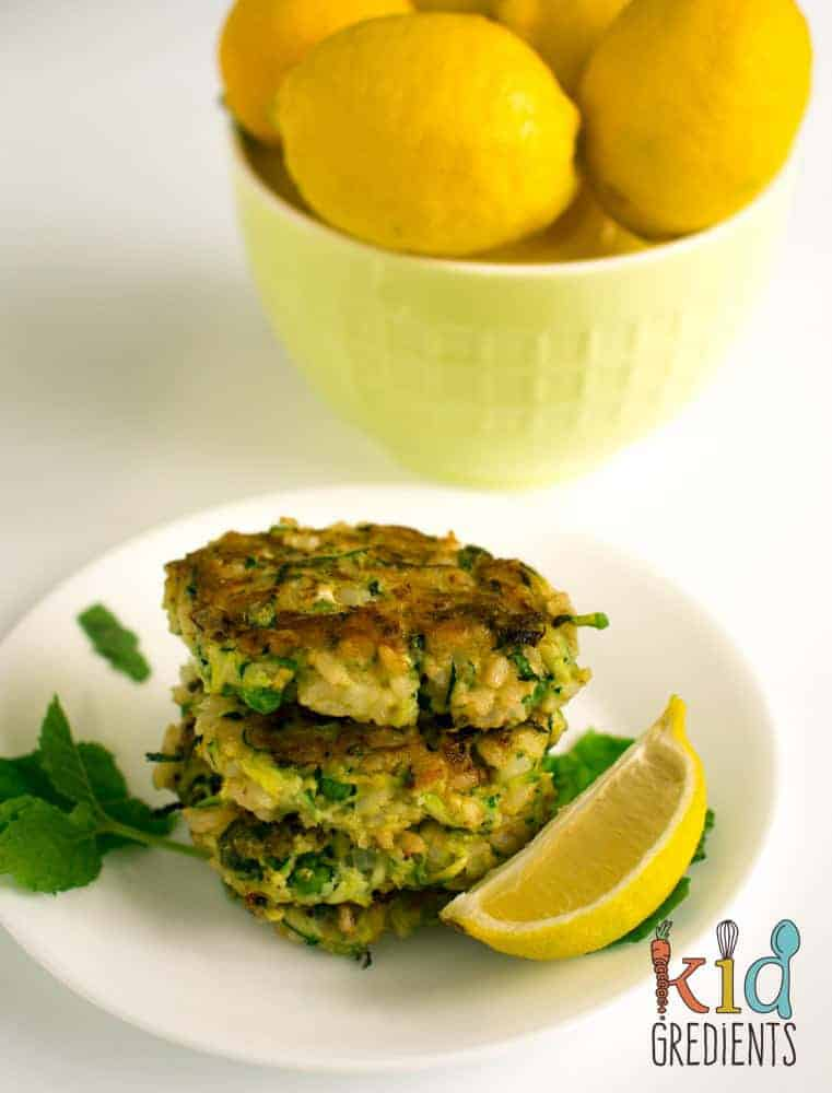 zucchini and pea brown rice fritters perfect as a dinenr side, easy recipe for lunchboxes, freezer friendly and kid friendly