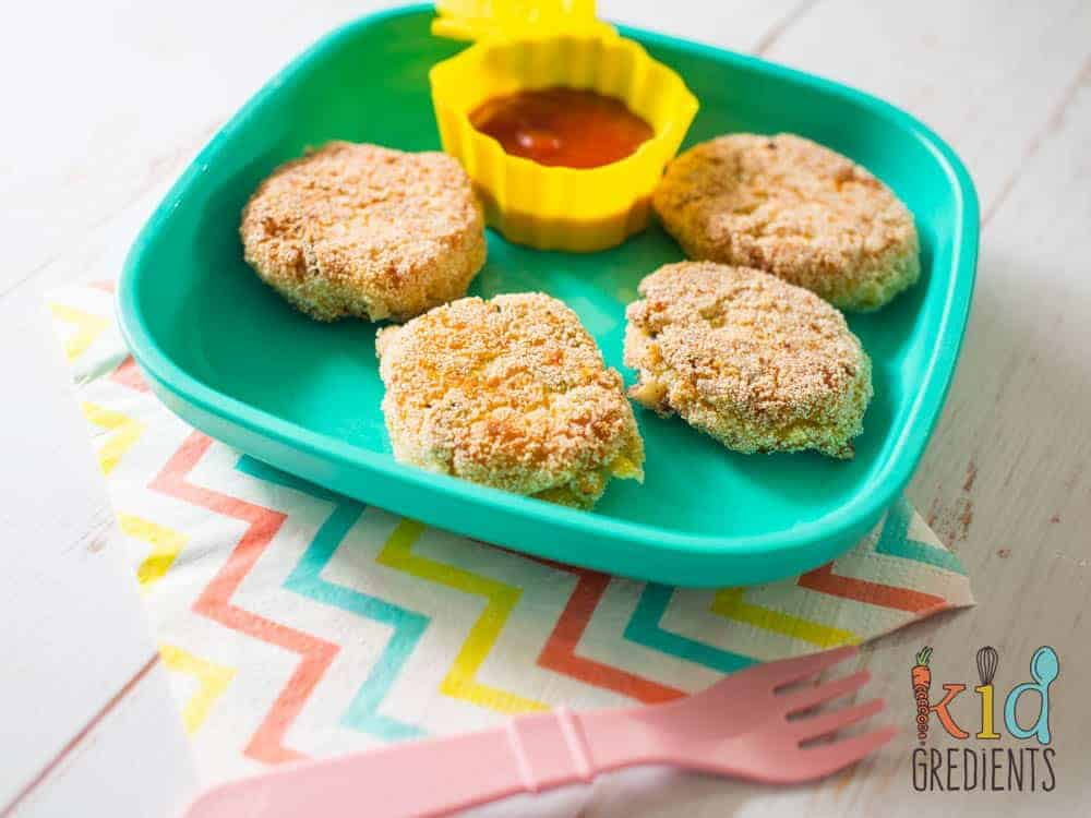 Veggie nuggets- packed with veggies and with a crunchy, yummy exterior, these are sure to please even the fusssiest anti-veggie kid! This recipe is great as a dinner side! Or works well cold in the lunchbox.
