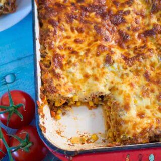 This easy bake mexican lasagna is awesome for filling the kids with veggies! Freezer friendly and super yummy.