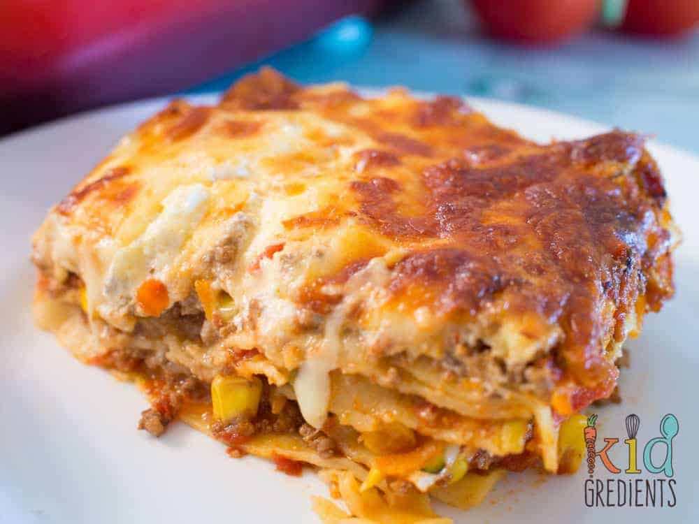 This easy bake veggie packed Mexican lasagna is awesome for filling the kids with veggies! Freezer friendly and super yummy.Simple, but tasty family recipe!