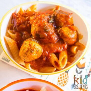 Cheesy chicken meatballs in cherry tomato pasta sauce