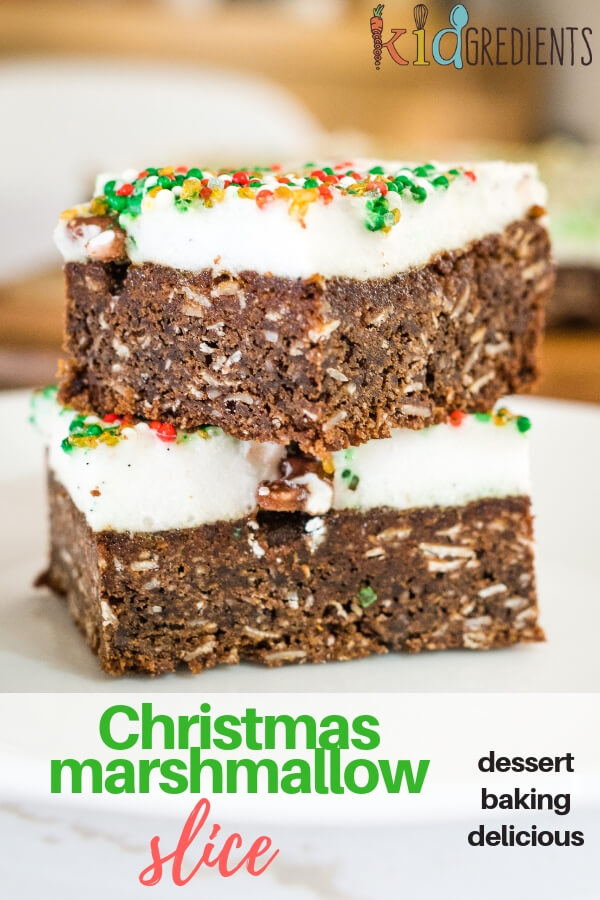 This sweet and delicious Christmas Marshmallow slice has a crunchy chocolate base and a fluffy marshmallow topping.  Perfect for sharing!  Magimix Cook Expert and conventional methods! Egg free. #kidgredients #kidsfood #baking #dessert #sweettreat #kidsdessert #christmas #festive