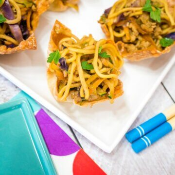 chicken and veggie noodles in baked wonton cups