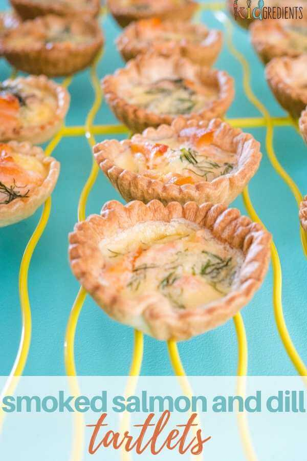 These smoked salmon and dill tartlet are just as perfect as finger food for a party as they are for the lunchbox.  Simple to make and extra yummy! #kidgredients #baking #lunchbox #salmon #smokedsalmon #homemade #tart #tartlets