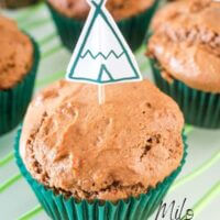 milo muffin with a cake topper of a teepee on a wire rack