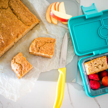 amazing food processor apple cake, cut into squares and some in a lunchbox