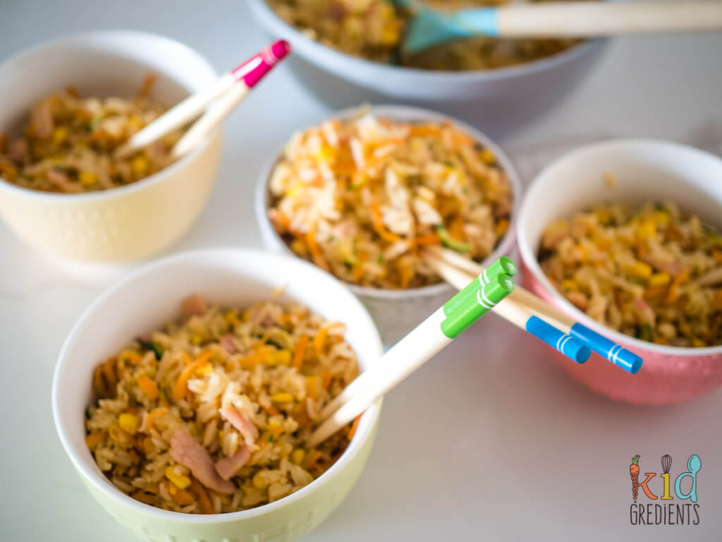 4 bowls of fried rice with chopsticks in the bowls