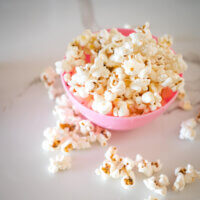 2 ingredient homemade popcorn spilling out of a bowl