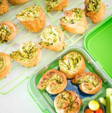 spinach pinwheels, in a lun chbox and on a wire cooling rack