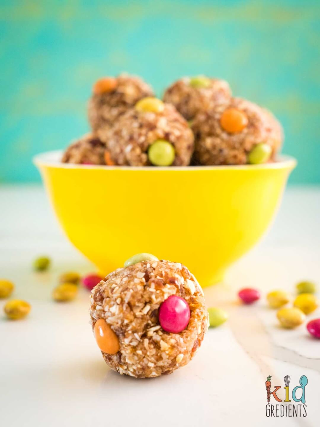 Caramel Chocolate bliss balls in a bowl and on the table
