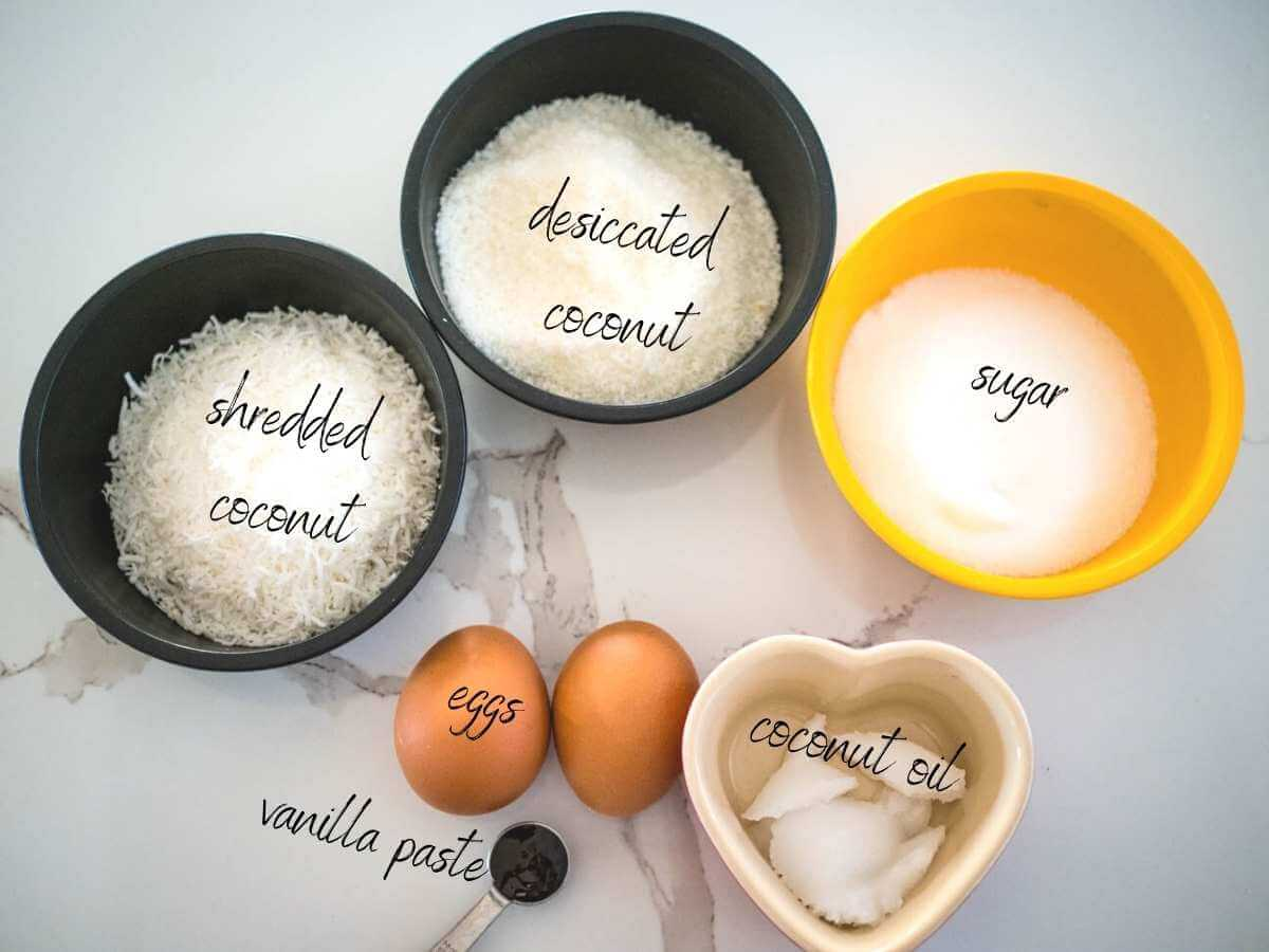 ingredients for coconut macaroons: desiccated coconut, shredded coconut, sugar, coconut oil, eggs and vanilla paste