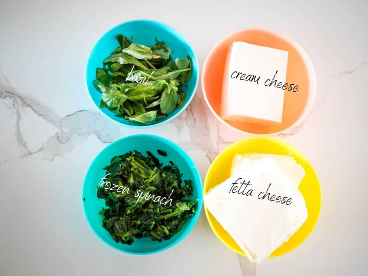 ingredients for creamy spinach and fetta dip: basil ,cream cheese, frozen spinach and fetta cheese